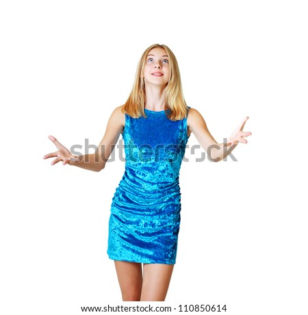 teen girl trying to catch something by hand she is in blue dress isolated over white