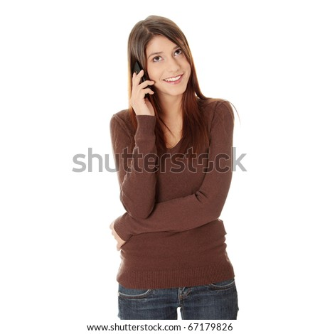 Teen girl using cell phone, isolated on white