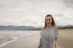 teen girl walking on Santa Monica beach in cloudy november