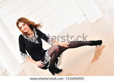 teen girl wearing dress posing