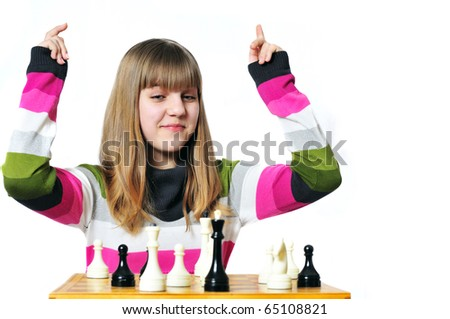 teen girl win chess, she made	checkmate - stock photo