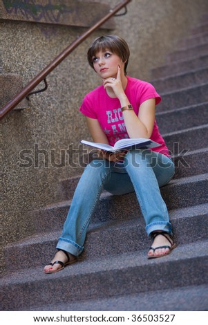 teen girl with book on the stairs