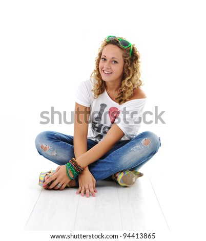 Teen girl with curly hair and sunglasses sitting