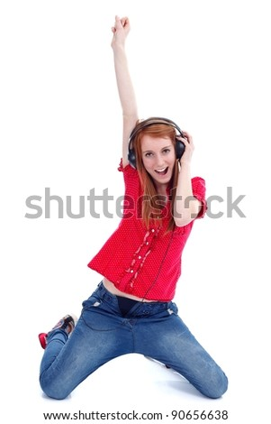 Teen girl with headphones listening music, having fun