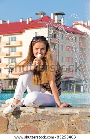teen girl with ice cream in street