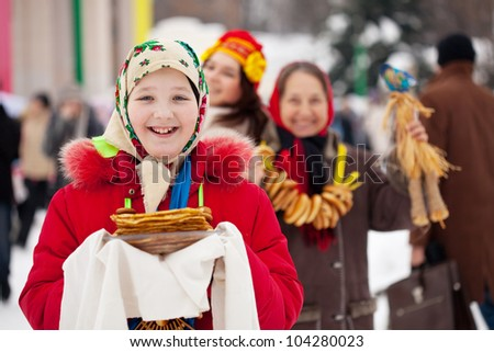 Teen girl with pancake during  Shrovetide at Russia