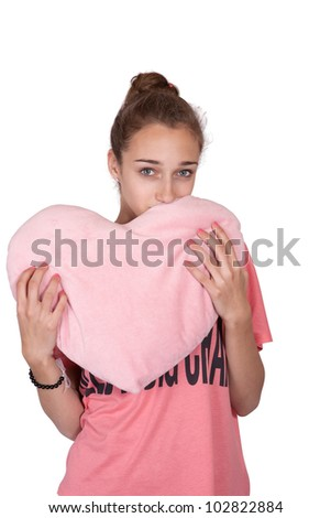 Teen girl with valentine pink heart isolated on white background