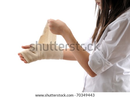 Teen girl wrapping her hand with a bandage isolated on white background - a series of MEDICAL images.