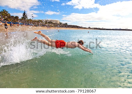 teen heads into the clear fresh ocean