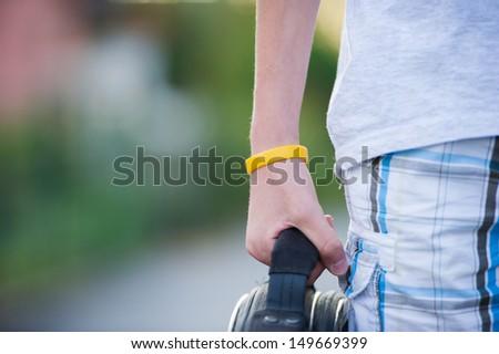 Teen holding a bag.