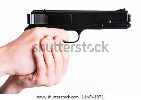 Teen holds a handgun on white background
