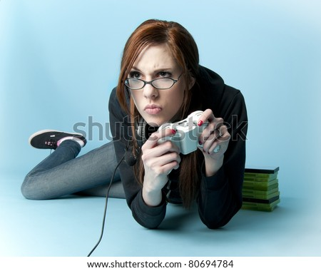 stock photo : Teen model holding video game controller lying on floor