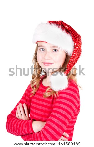 Teen or child wearing Santa hat holding Christmas presents on an isolated white background