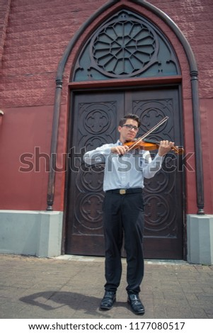 Teen playing violin on the street