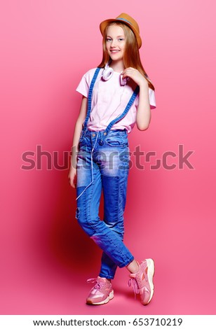 07201ac31a54 Teen s fashion. Cute girl teenager wearing summer jeans and t-shirt posing over  pink