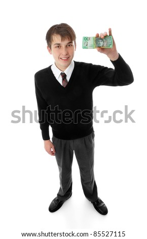 Teen school boy holding a wad of cash  up in one hand. eg charity, fundraiser, fees, etc.