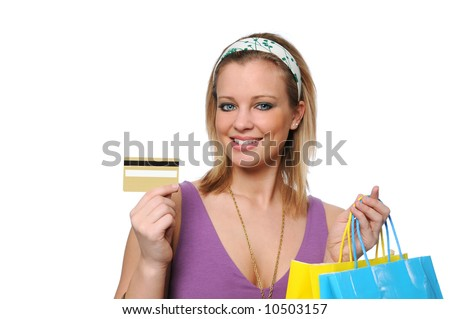 stock photo : Teen shopping showing a credit card isolated on white