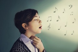 teen singer boy sing close up portrait on blue background