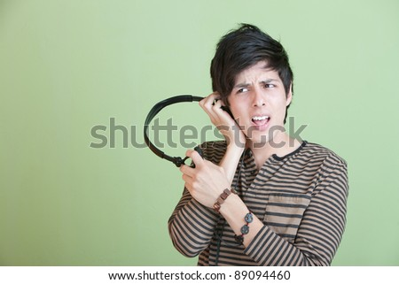 Teen Singing Along with Music On headphones