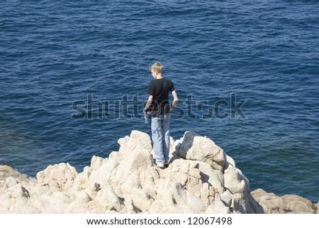 teen standing on cliffs - gulf of saint-tropez, French Riviera