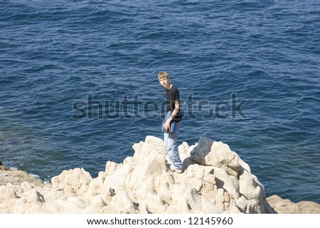 teen standing on cliffs - gulf of saint-tropez, French Riviera