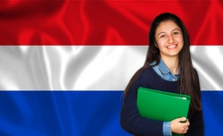 Teen student smiling over Dutch flag. Concept of lessons and learning of foreign languages.
