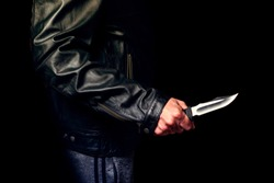 Teen threatened with a knife on the street, night lighting