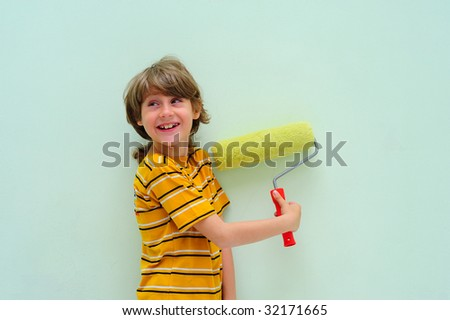 Teen With Roller Against The Light Green Wall.