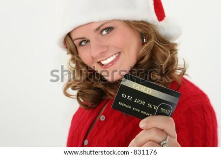 stock photo teen woman holiday christmas shopping with credit card debt 831176 stock photo : Teen woman holiday christmas shopping with credit card debt.
