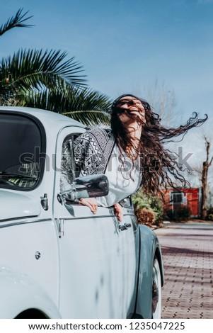 Teen woman inside a car #1235047225