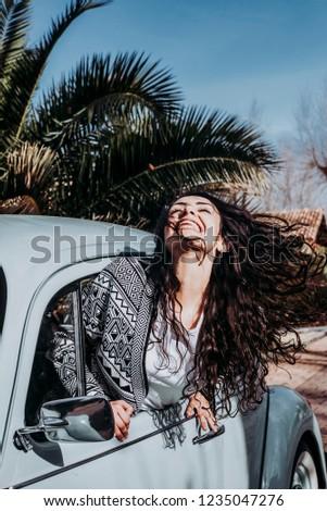 Teen woman inside a car #1235047276