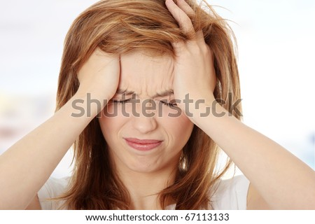 stock photo : Teen woman with headache holding her hand to the head