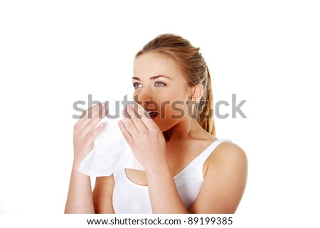 Teen woman with tissue - sneezing
