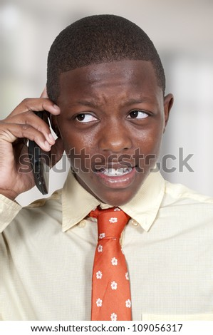 Teenage African American boy talking on the phone - stock photo