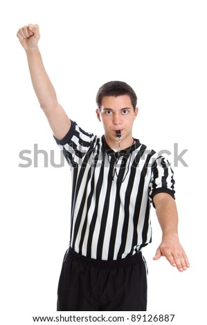 Teenage basketball referee giving sign for foul