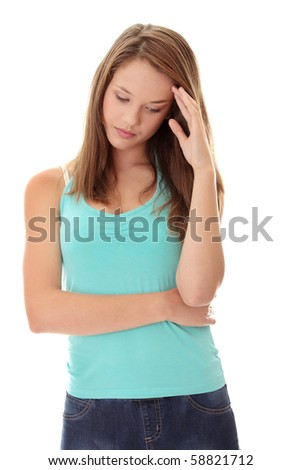 Teenage beautiful woman with depression isolated on white