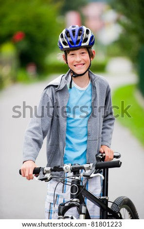Teenage boy cycling and hanging out in a suburban setting.