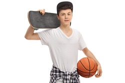 Teenage boy holding a skateboard and a basketball isolated on white background