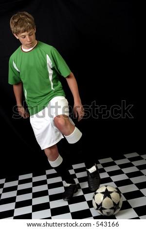 Teenage boy in soccer uniform
