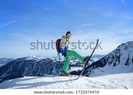 Teenage boy on slope on skiing holiday, Tirol, Austria, Europe