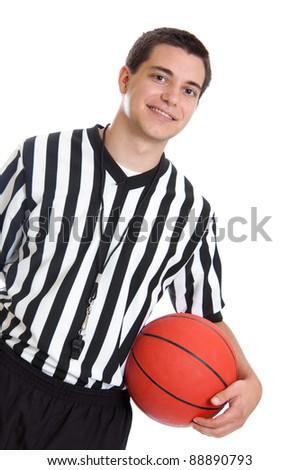 Teenage boy referee holding a basketball
