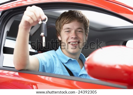 Teenage Boy Sitting In Car Holding Car Keys