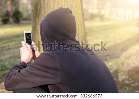 teenage boy taking photographs with a smart phone