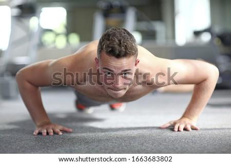 Teenage boy training in gym, portrait