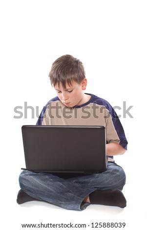 teenage boy with a laptop on a white background