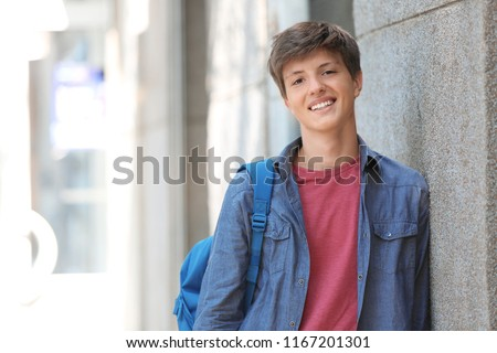 Teenage boy with backpack outdoors