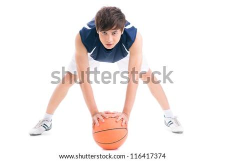 Teenage boy with basketball