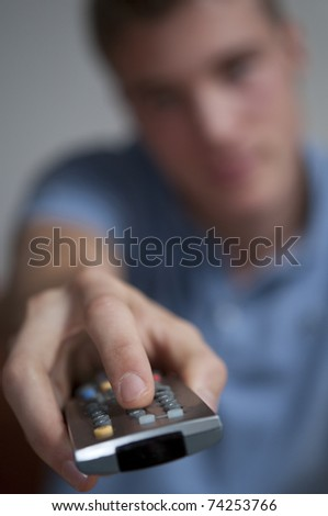 Teenage Boy with TV remote control
