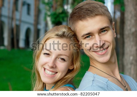 Teenage couple at the park with copy space