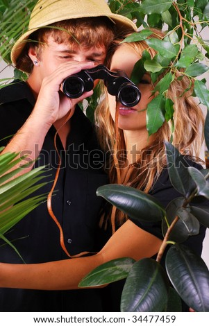 http://image.shutterstock.com/display_pic_with_logo/52593/52593,1248957028,2/stock-photo-teenage-couple-wearing-safari-hat-with-binoculars-adventuring-in-the-jungle-34477459.jpg